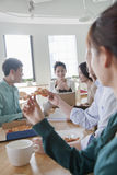 Coworkers eating and working in the cafeteria Stock Photography