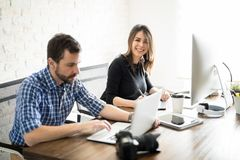 Coworkers editing professional photos Royalty Free Stock Photography