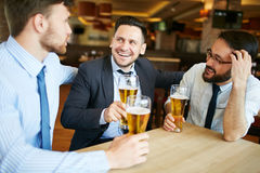 Coworkers Enjoying Beer Royalty Free Stock Images