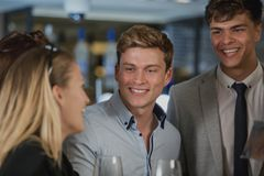 Businesspeople Enjoying After-Work Drinks stock image