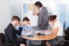 Coworkers getting bored Royalty Free Stock Photos