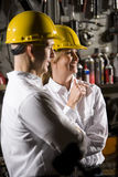 Coworkers in hard hats royalty free stock images
