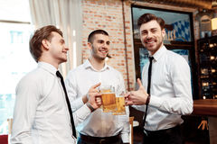 Coworkers have fun in the bar Stock Photography