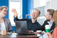 Coworkers having a chat Royalty Free Stock Images