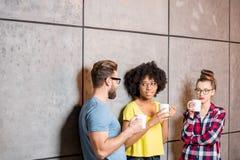 Coworkers having a coffee break Stock Photo