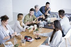 Coworkers having lunch royalty free stock images