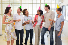Coworkers laugh and celebrate accomplishment and enjoy party Stock Photography