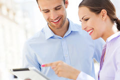 Coworkers looking at digital tablet Royalty Free Stock Photo