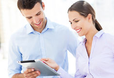 Coworkers looking at digital tablet Royalty Free Stock Images