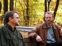 Coworkers on lunch break. Lunchtime discussion in an autumn setting royalty free stock photography