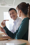 Coworkers on the lunch break, talking Stock Photo