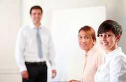 Coworkers during a meeting smiling at you Stock Image