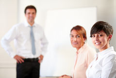 Coworkers during a meeting smiling at you Stock Photography