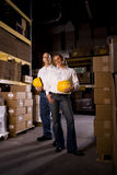 Coworkers in office storage room Stock Photos
