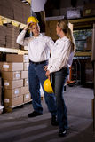 Coworkers in office storage room Stock Photo