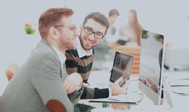 Coworkers photo in sunny office. Coworkers working in sunny office. Successful businass team Stock Image