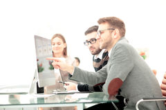 Coworkers photo in sunny office. Coworkers working in sunny office. Successful businass team stock photos