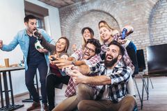 Coworkers playing video games. In office Royalty Free Stock Photo