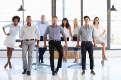 Coworkers posing to camera in meeting room Royalty Free Stock Photos