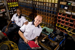 Coworkers in printshop Stock Image