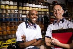 Coworkers in printshop Stock Photography