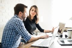 Coworkers sharing ideas Royalty Free Stock Photography