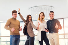 Coworkers showing thumbs up Royalty Free Stock Images