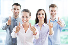 Coworkers showing thumbs up Royalty Free Stock Photography