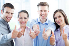Coworkers showing thumbs up Stock Photography