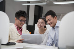 Coworkers smiling and discussing project Stock Photography