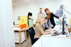 Coworkers solving problems together Royalty Free Stock Images