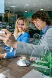 Coworkers taking a selfie. During coffee break Stock Photography