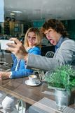Coworkers taking a selfie Royalty Free Stock Photography