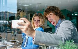 Coworkers taking a selfie. During coffee break Stock Image