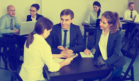 Coworkers talking about business project in office Royalty Free Stock Photos