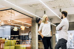 Coworkers talking in office Stock Photography