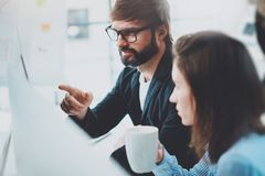 Coworkers team at modern office.Project managers work new idea.Young business crew working with startup studio.Blurred stock photo