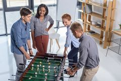 Coworkers team playing table football Stock Photography