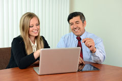 Coworkers Viewing Information on Laptop Royalty Free Stock Photography