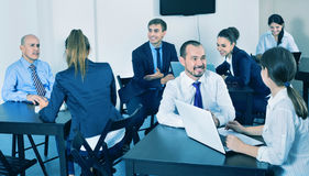 Coworkers working effectively on business project together Royalty Free Stock Photography