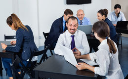 Coworkers working effectively on business project together Stock Photo