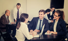 Coworkers working effectively on business project together Stock Photos