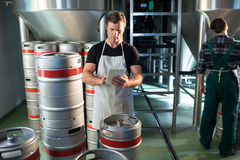 Coworkers working in factory. Coworkers working in brewery factory Royalty Free Stock Photos