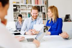 Coworkers working on project together stock photo