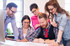 Coworkers working on project together in office. Business Coworkers and architects working on project together in office Stock Images