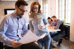 Coworkers working on project together in office Royalty Free Stock Photo