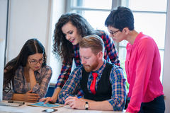 Coworkers working on project together in office Royalty Free Stock Photography