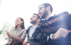 Coworkers working in sunny office. Successful businass team. Bot Stock Image
