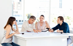Coworkers working in their office Stock Photography