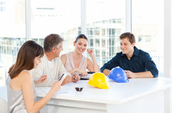 Coworkers working in their office Stock Images